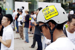 Unidentified man with campaign sticker on helmet for against the construction of a dam Royalty Free Stock Photo