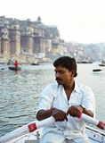 Unidentified man close up rowing boat on the river Ganges early morning royalty free stock photos