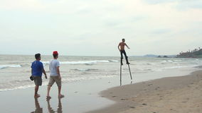 Unidentified man dancing on the stilts stock video footage