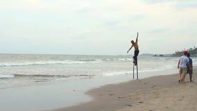 Unidentified man dancing on the stilts. Goa state Arambol beach. stock video
