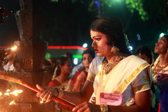 An unidentified man dressed as woman participates in the Hindu ritual called Chamayavilakku held in Kottangulangara temple Royalty Free Stock Photo