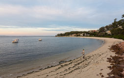 An unidentified man fishes in Nelson Bay. Royalty Free Stock Photo