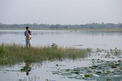 Unidentified man fishing in Huayyang reservoir Royalty Free Stock Photography