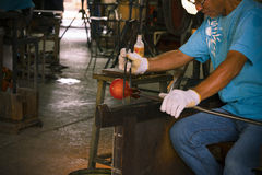 Unidentified Man forming a hot glass at Ryukyu Glass Village Stock Photos