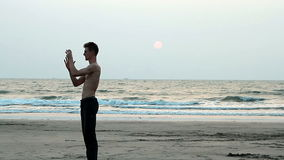 Unidentified man juggling with glass ball on the beach. Goa, India – February 10, 2016: Unidentified man juggling with glass ball on the beach stock footage