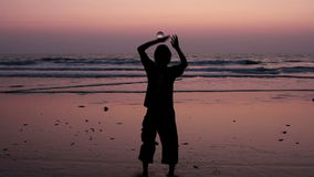 Unidentified man juggling with glass ball on the beach. Goa, India – February 10, 2016: Unidentified man juggling with glass ball on the beach stock video