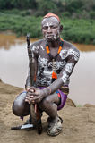 Unidentified man from Karo tribe with gun Royalty Free Stock Image