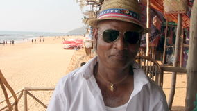 Unidentified man listening music. Goa, India – February 24, 2016: Unidentified man listening music stock video
