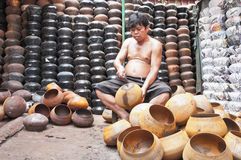 An unidentified man make monk's alms-bowl Royalty Free Stock Images