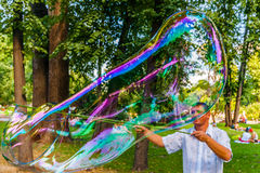 Unidentified man makes huge soap bubble in Moscow  Stock Photo