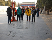 Unidentified man paints Chinese characters caligraphy Stock Image