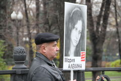 An unidentified man with a placard in support of. Moscow, Russia - 27 October 2013. The March of the Russian opposition in support of political prisoners. An Stock Photo