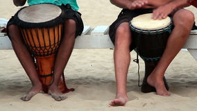 Unidentified man playing on drum at the Arambol beach. Goa, India - February 27, 2016: Unidentified man playing on drum at the Arambol beach stock video footage