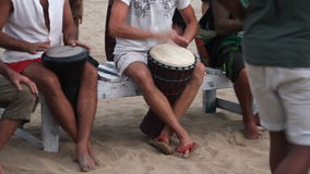 Unidentified man playing on drum at the beach. Goa state Arambol beach. Goa, India – February 28, 2015: Unidentified man playing on drum at the beach. Goa stock video footage
