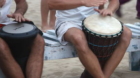 Unidentified man playing on drum at the beach. Goa state Arambol beach. Goa, India – February 28, 2015: Unidentified man playing on drum at the beach. Goa stock footage