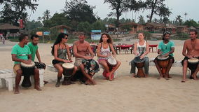 Unidentified man playing on drums. Goa, India – February 27, 2016: Unidentified man playing on drums stock video footage