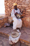 Unidentified man playing traditional moroccan instrument  in Ait Stock Photos