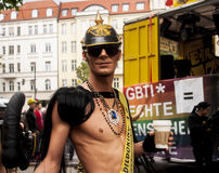 Unidentified man with Prussia helmet on head. BERLIN, GERMANY - JUNE 21, 2014: Christopher Street Day.Crowd of people Participate in the parade celebrates gays Royalty Free Stock Photos