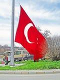 Unidentified man raises the Turkey flag, Istanbul. Turkey stock photo