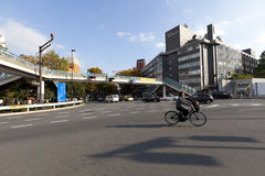 Unidentified man riding bicycle on street near Harajuku Royalty Free Stock Photo