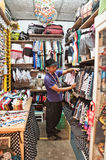 An unidentified  man run a clothing store in Chatuchak market. Royalty Free Stock Image