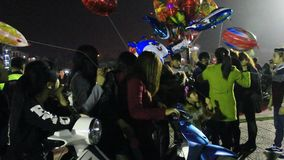 An unidentified man selling the balloons on street. Haiduong, Vietnam, An unidentified man selling the balloons on street stock video