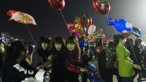 An unidentified man selling the balloons on street stock footage