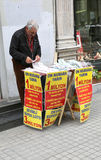 Unidentified man selling lottery ticket at Istiklal Street Royalty Free Stock Images