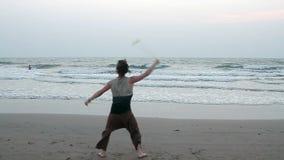 Unidentified man spinning poi on the beach. Goa, India - February 15, 2016: Unidentified man spinning poi on the beach stock footage