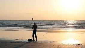 Unidentified man spinning pole on the beach. Goa, India - February 10, 2016: Unidentified man spinning pole on the beach stock footage