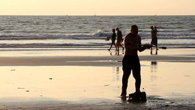 Unidentified man spinning pole on the beach. stock footage