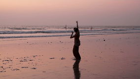 Unidentified man spinning pole on the beach. Goa, India - February 23, 2016: Unidentified man spinning pole on the beach stock video