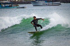 Unidentified man surfing in Mann beach, San Royalty Free Stock Photo
