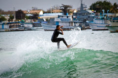 Unidentified man surfing in San Cristobal Island Royalty Free Stock Photography