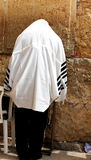 Unidentified man in tefillin  praying at the Wailing wall (Western wall) Stock Image