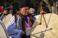 The drummer 2. Unidentified man in traditional romanian clothes playing the drums on Traditional Bear Dance parade in Comanesti, Romania, 2017 Stock Photography