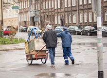 An unidentified man transports discarded materials Royalty Free Stock Photography