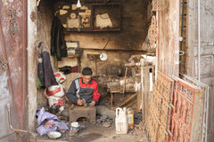 Unidentified man working in the street of Meknes, Morocco. Meknes is one of the four Imper. MEKNES, MOROCCO - FEBRUARY 18, 2017: Unidentified man working in the Stock Photography