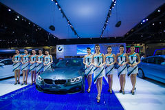 Unidentified many modelling posted with BMW 420d Coupe Sport Royalty Free Stock Photography
