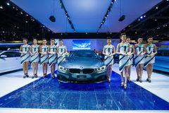 Unidentified many modelling posted with BMW 420d Coupe Sport Stock Photography