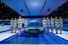 Unidentified many modelling posted with BMW 420d Coupe Sport Stock Photos