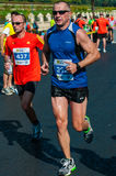 Unidentified marathon runner competes Stock Photos