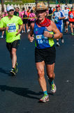 Unidentified marathon runner competes Stock Images