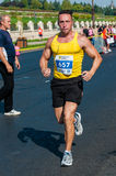 Unidentified marathon runner competes. BUCHAREST, ROMANIA - OCTOBER 7: An unidentified marathon runner competes at the Bucharest International Marathon 2012 Stock Photos