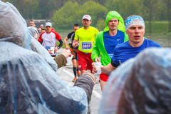 Unidentified Marathon runner picking up water at service point during  16 Cracovia marathon Stock Photography