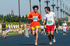 Unidentified marathon runners compete Royalty Free Stock Photos