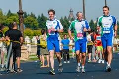 Unidentified marathon runners compete. BUCHAREST, ROMANIA - OCTOBER 7: Unidentified marathon runners compete at the Bucharest International Marathon 2012 Stock Image