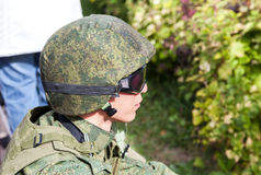 Unidentified member of military club in camouflage army uniform Royalty Free Stock Image