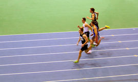 Unidentified men on the 60 meters dash Stock Images