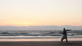 Men dancing on the beach. Unidentified men dancing on the beach stock footage